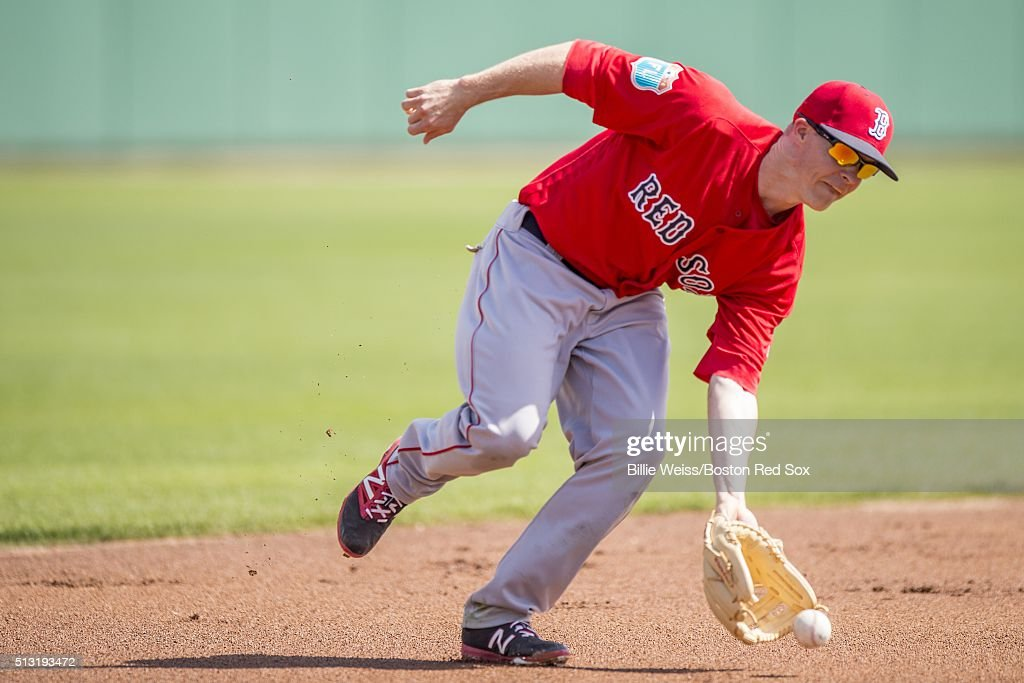 Brock Holt #12 of the Boston Red Sox fields a ground ball during a team workout on March 1, 2016 at Fenway South in Fort Myers, Florida .