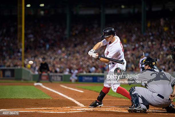 Brock Holt of the Boston Red Sox hits a leadoff single against the New York Yankees in the first inning on August 3 2014 at Fenway Park in Boston...