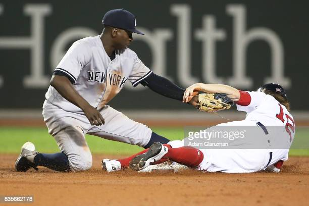 Brock Holt of the Boston Red Sox is tagged out while trying to steal second base by Didi Gregorius of the New York Yankees in the ninth inning of a...