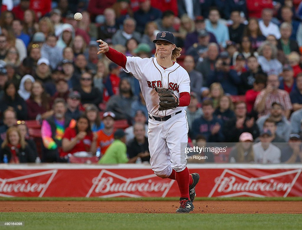 Brock Holt #26 of the Boston Red Sox makes an assist against the Baltimore Orioles in the seventh inning at Fenway Park on September 26, 2015 in Boston, Massachusetts.