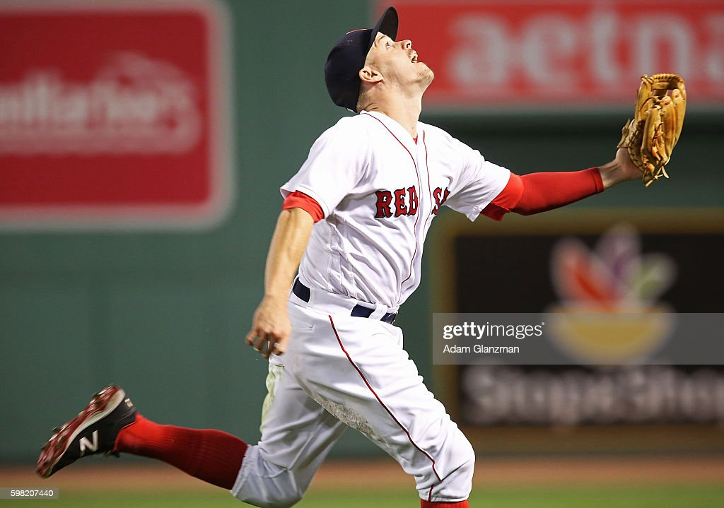 Brock Holt of the Boston Red Sox reaches for a ball during a game against the Tampa Bay Rays at Fenway Park on August 29 2016 in Boston Massachusetts