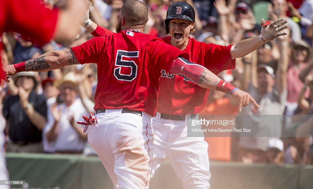 <a gi-track='captionPersonalityLinkClicked' href=/galleries/search?phrase=Brock+Holt&family=editorial&specificpeople=9690034 ng-click='$event.stopPropagation()'>Brock Holt</a> #26 of the Boston Red Sox reacts after <a gi-track='captionPersonalityLinkClicked' href=/galleries/search?phrase=Jonny+Gomes&family=editorial&specificpeople=568435 ng-click='$event.stopPropagation()'>Jonny Gomes</a> #5 scored the winning run against the Baltimore Orioles in the ninth inning during the first game of a doubleheader at Fenway Park on July 5, 2014 in Boston, Massachusetts.