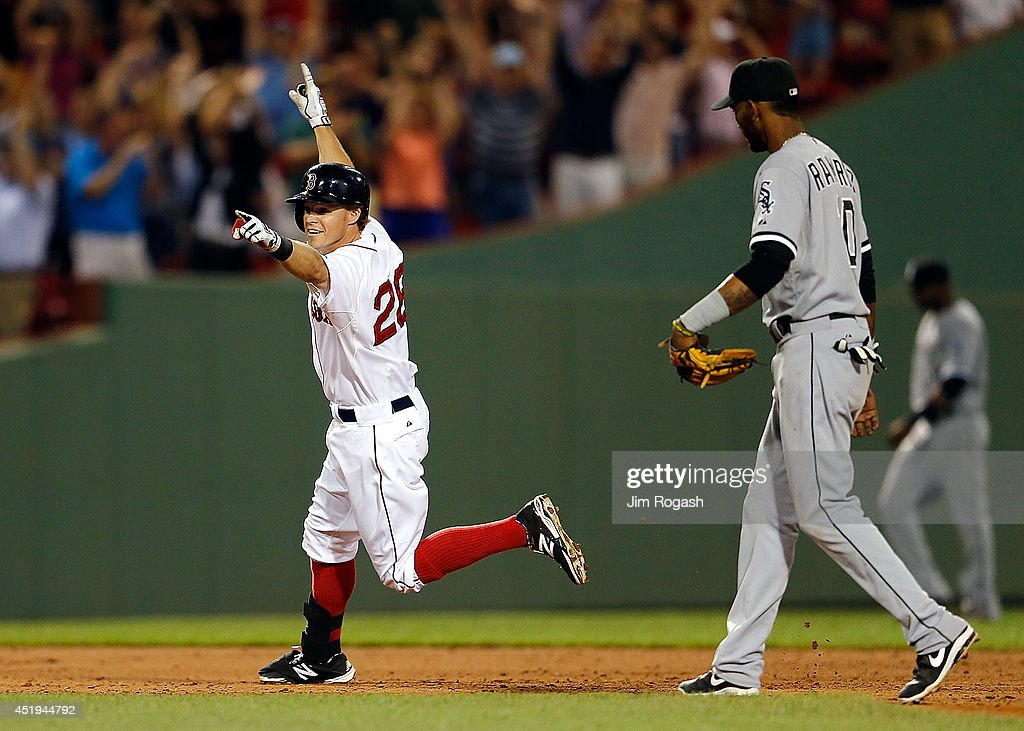 Brock Holt #26 of the Boston Red Sox reacts after knocking in the winning run in the ninth inning as Alexei Ramirez #10 of the Chicago White Sox leaves the field at Fenway Park on July 9, 2014 in Boston, Massachusetts.