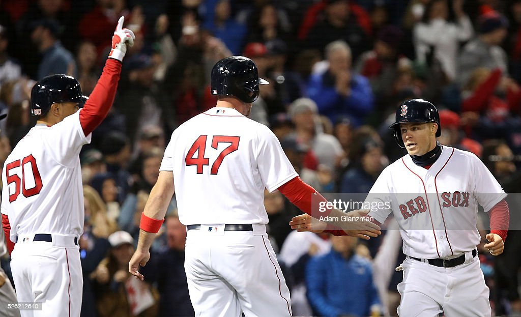 <a gi-track='captionPersonalityLinkClicked' href=/galleries/search?phrase=Brock+Holt&family=editorial&specificpeople=9690034 ng-click='$event.stopPropagation()'>Brock Holt</a> #12 of the Boston Red Sox returns to the dugout after scoring in the seventh inning in the game against the New York Yankees at Fenway Park on April 29, 2016 in Boston, Massachusetts.