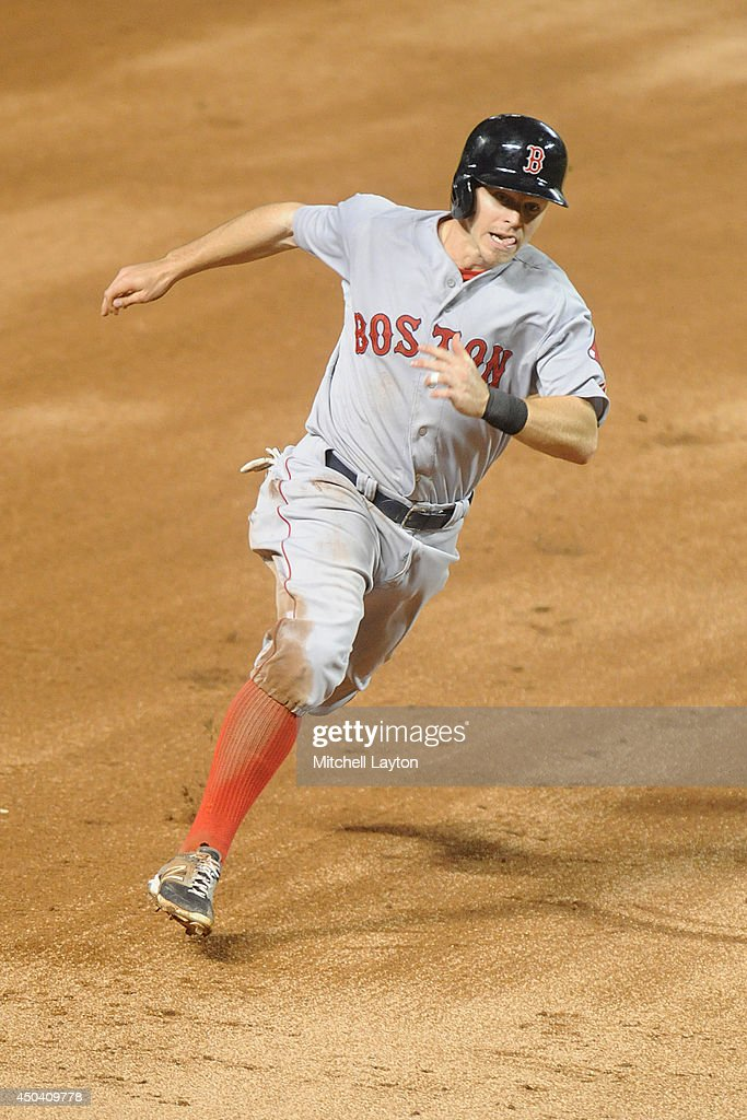 Brock Holt #26 of the Boston Red Sox runs home on a Mike Napoli #12 (not pictured) hit in the third inning to score games only run during a baseball game against the Baltimore Orioles on June 10, 2014 at Oriole Park at Camden Yards in Baltimore, Maryland. The red Sox won 1-0.