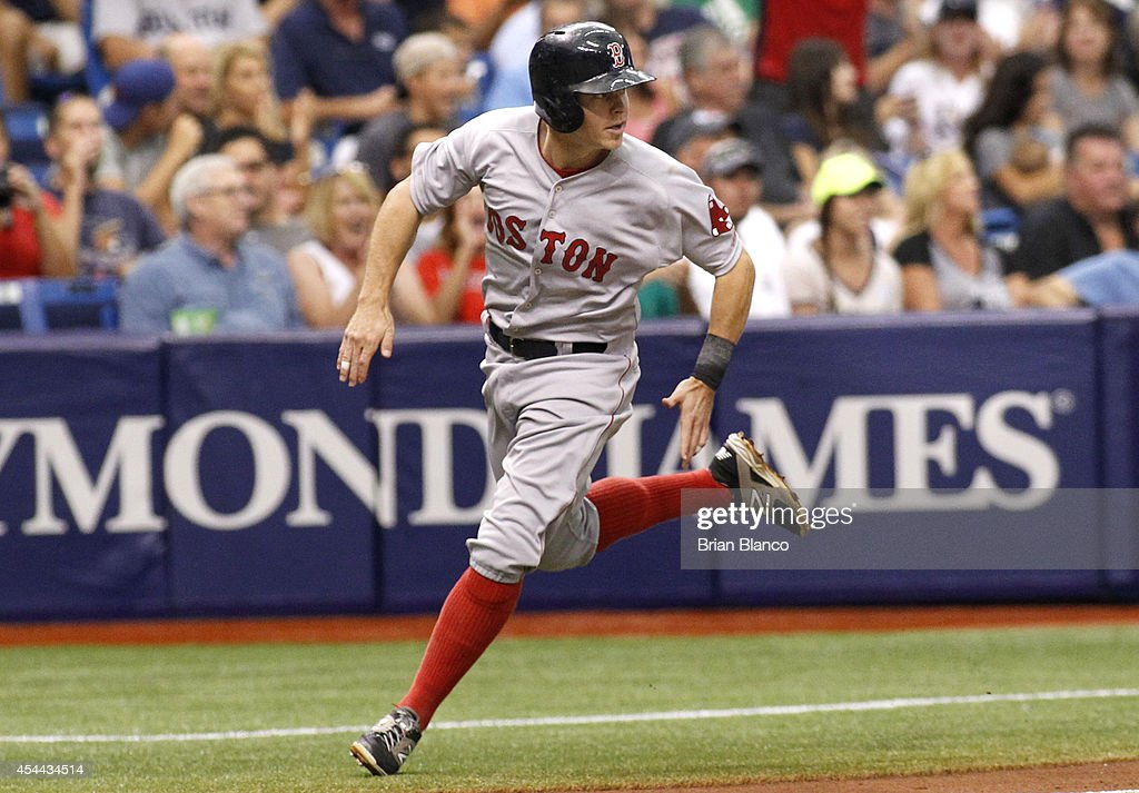 Brock Holt #26 of the Boston Red Sox sprints toward home to score off of a single by Mookie Betts during the fifth inning of a game on August 31, 2014 at Tropicana Field in St. Petersburg, Florida.