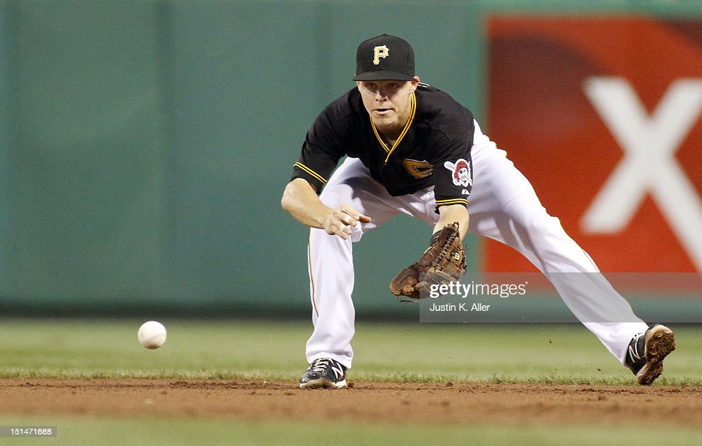 Brock Holt #2 of the Pittsburgh Pirates fields a ground ball against the Chicago Cubs during the game on September 7, 2012 at PNC Park in Pittsburgh, Pennsylvania.