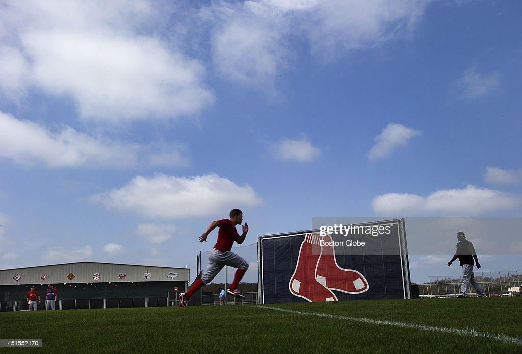 Brock Holt runs sprints during workout at JetBlue Park