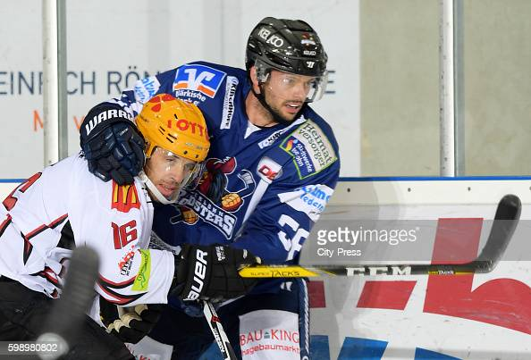 Brock Hooton of the Fischtown Pinguins and David Dziurzynski of the Iserlohn Roosters during the test match between the Fischtown Pinguins and the...