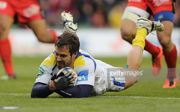 Brock James of ASM Clermont Auvergne scores his team's second try during the Heineken Cup final match between Clermont Auvergne and RC Toulon at the...