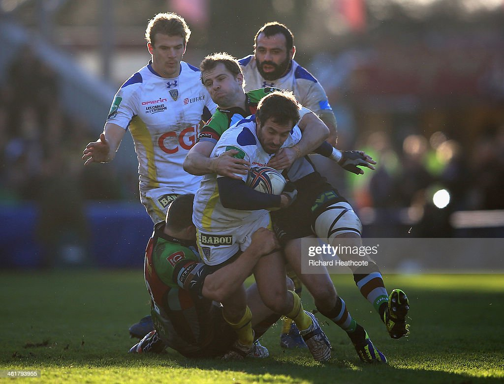 <a gi-track='captionPersonalityLinkClicked' href=/galleries/search?phrase=Brock+James&family=editorial&specificpeople=636412 ng-click='$event.stopPropagation()'>Brock James</a> of Clermont is tackled by Tim Molenaar and <a gi-track='captionPersonalityLinkClicked' href=/galleries/search?phrase=Nick+Evans+-+Rugby+Player&family=editorial&specificpeople=724634 ng-click='$event.stopPropagation()'>Nick Evans</a> of Quins during the Heineken Cup match between Harlequins and Clermont Auvergne at the Twickenham Stoop on January 11, 2014 in London, England.