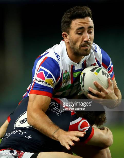 Brock Lamb of the Knights is tackled during the round 20 NRL match between the Sydney Roosters and the Newcastle Knights at Allianz Stadium on July...