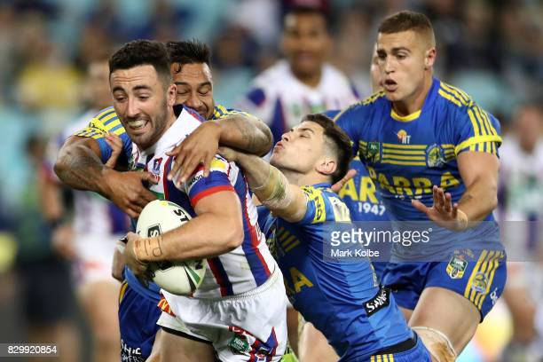 Brock Lamb of the Knights scores a try during the round 23 NRL match between the Parramatta Eels and the Newcastle Knights at ANZ Stadium on August...
