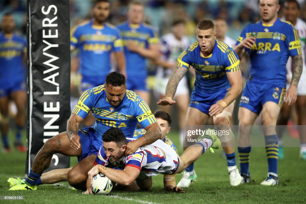 Brock Lamb of the Knights scores a try during the round 23 NRL match between the Parramatta Eels and the Newcastle Knights at ANZ Stadium on August 11, 2017 in Sydney, Australia.
