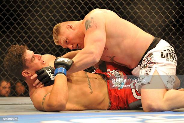 Brock Lesnar holds down Frank Mir during their heavyweight title bout during UFC 100 on July 11 2009 in Las Vegas Nevada