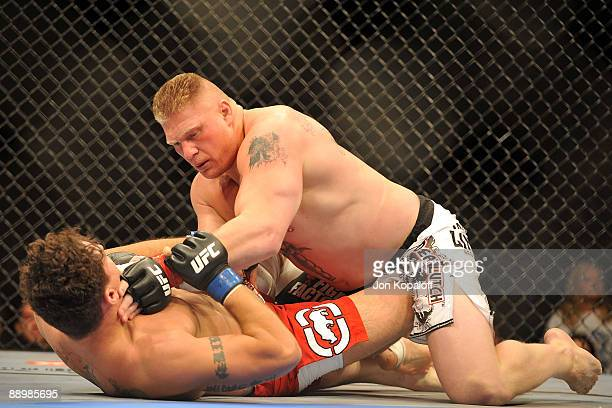 Brock Lesnar holds down Frank Mir during their heavyweight title bout during UFC 100 on July 11 2009 in Las Vegas Nevada Lesnar defeated Mir by a...