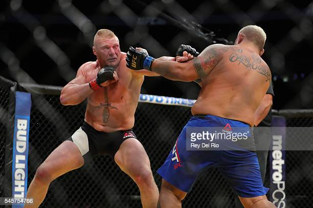 Brock Lesnar punches Mark Hunt during the UFC 200 event at TMobile Arena on July 9 2016 in Las Vegas Nevada