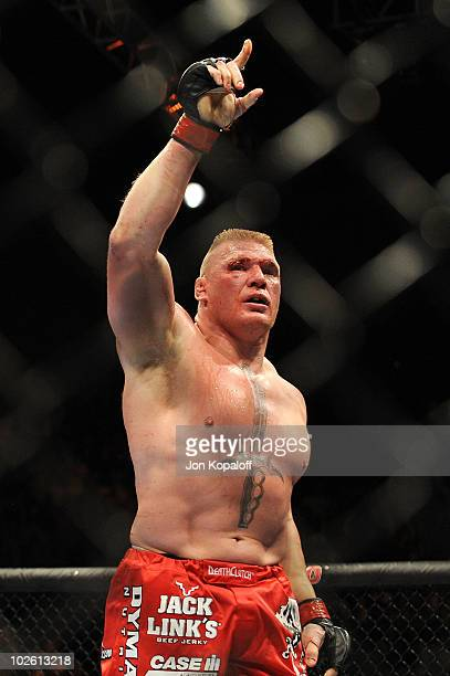 Brock Lesnar reacts after his second round submission of Shane Carwin to win the UFC Heavyweight Championship Unification bout at the MGM Grand...