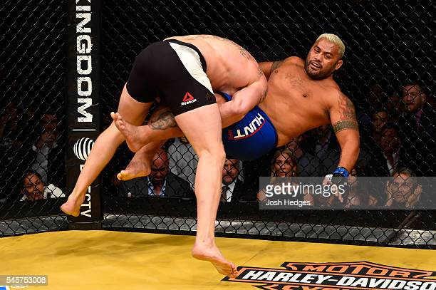 Brock Lesnar takes down Mark Hunt of New Zealand in their heavyweight bout during the UFC 200 event on July 9 2016 at TMobile Arena in Las Vegas...