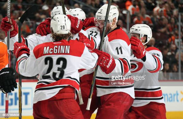 Brock McGinn Noah Hanifin Brett Pesce Jordan Weal and Teuvo Teravainen of the Carolina Hurricanes celebrate a third period goal against the...