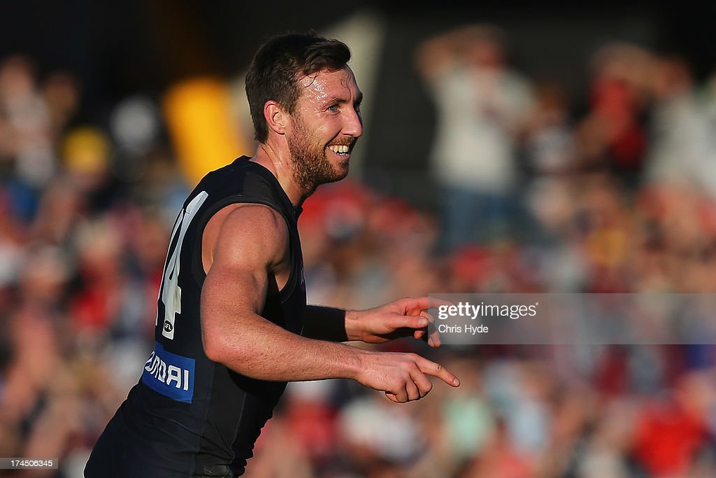 <a gi-track='captionPersonalityLinkClicked' href=/galleries/search?phrase=Brock+McLean&family=editorial&specificpeople=239175 ng-click='$event.stopPropagation()'>Brock McLean</a> of the Blues celebrates a goal during the round 18 AFL match between the Gold Coast Suns and the Carlton Blues at Metricon Stadium on July 27, 2013 in Gold Coast, Australia.