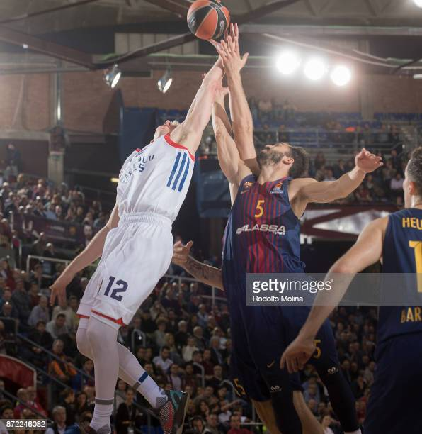 Brock Motum #12 of Anadolu Efes Istanbul competes with Pau Ribas #5 of FC Barcelona Lassa during the 2017/2018 Turkish Airlines EuroLeague Regular...