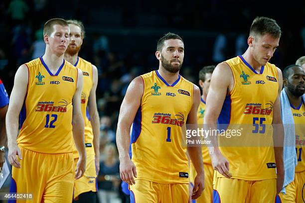 Brock Motum Adam Gibson and Mitch Creek of Adelaide leave the court following game one of the NBL Finals series between the New Zealand Breakers and...