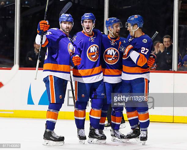 Brock Nelson of the New York Islanders celebrates with his teamates after scoring a goal against the Ottawa Senators during their game at the...