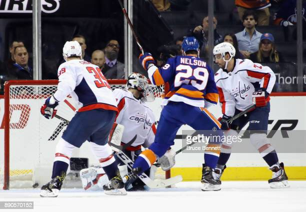 Brock Nelson of the New York Islanders scores at 236 of the first period against Braden Holtby of the Washington Capitals at the Barclays Center on...