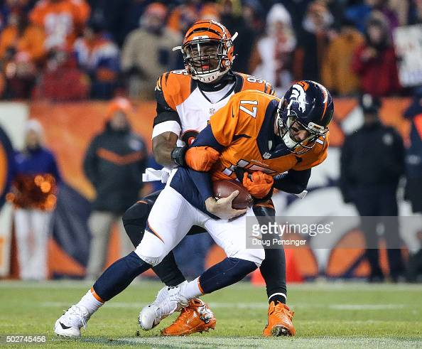 Brock Osweiler is sacked by defensive end Carlos Dunlap of the Cincinnati Bengals during a game at Sports Authority Field at Mile High on December 28...