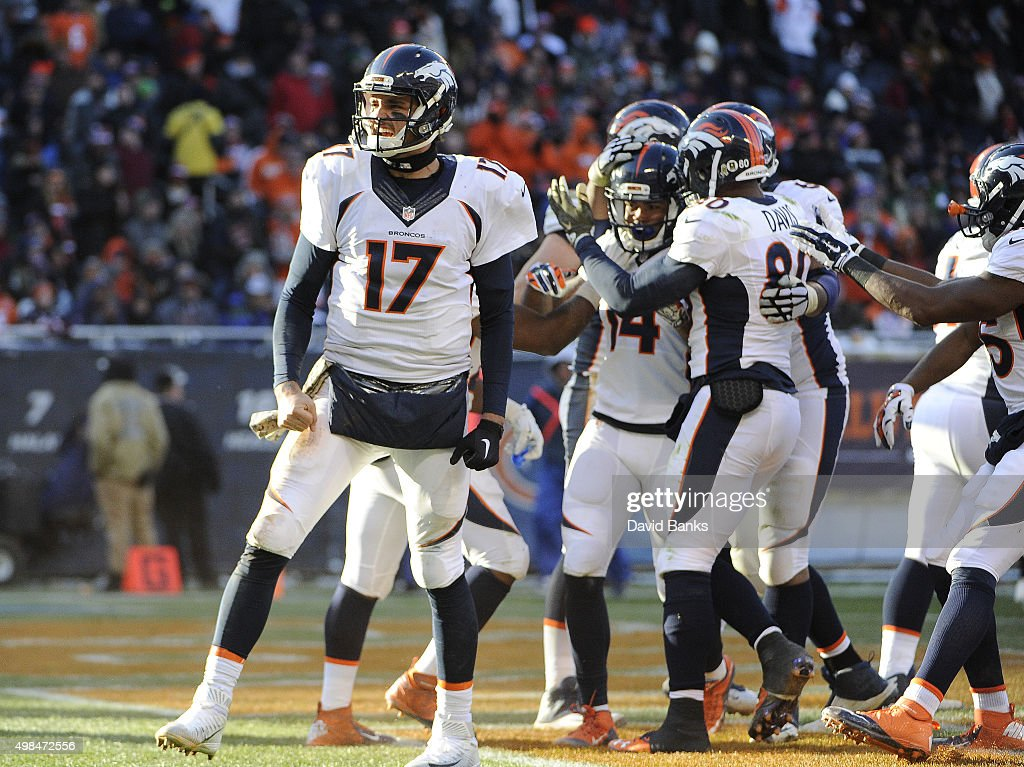 <a gi-track='captionPersonalityLinkClicked' href=/galleries/search?phrase=Brock+Osweiler&family=editorial&specificpeople=6501030 ng-click='$event.stopPropagation()'>Brock Osweiler</a> #17 of the Denver Broncos reacts after throwing a touchdown to <a gi-track='captionPersonalityLinkClicked' href=/galleries/search?phrase=Cody+Latimer&family=editorial&specificpeople=8534820 ng-click='$event.stopPropagation()'>Cody Latimer</a> #14 against the Chicago Bears on November 22, 2015 at Soldier Field in Chicago, Illinois.