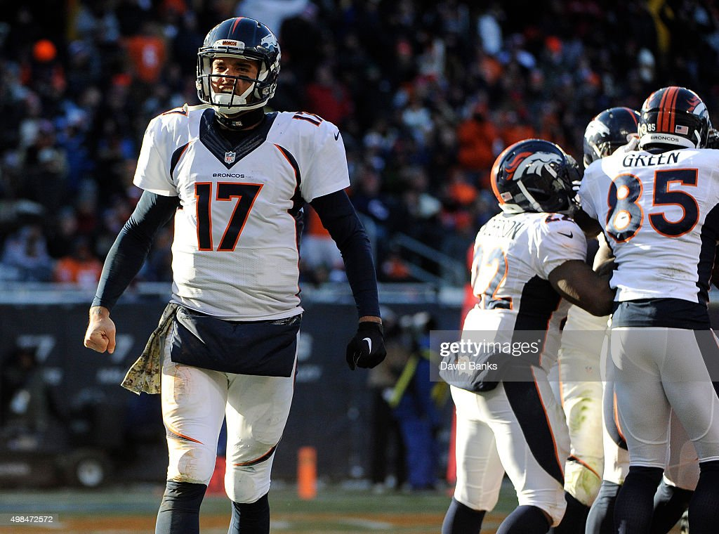 <a gi-track='captionPersonalityLinkClicked' href=/galleries/search?phrase=Brock+Osweiler&family=editorial&specificpeople=6501030 ng-click='$event.stopPropagation()'>Brock Osweiler</a> #17 of the Denver Broncos reacts after throwing a touchdown to Cody Latimer #14 against the Chicago Bears on November 22, 2015 at Soldier Field in Chicago, Illinois.