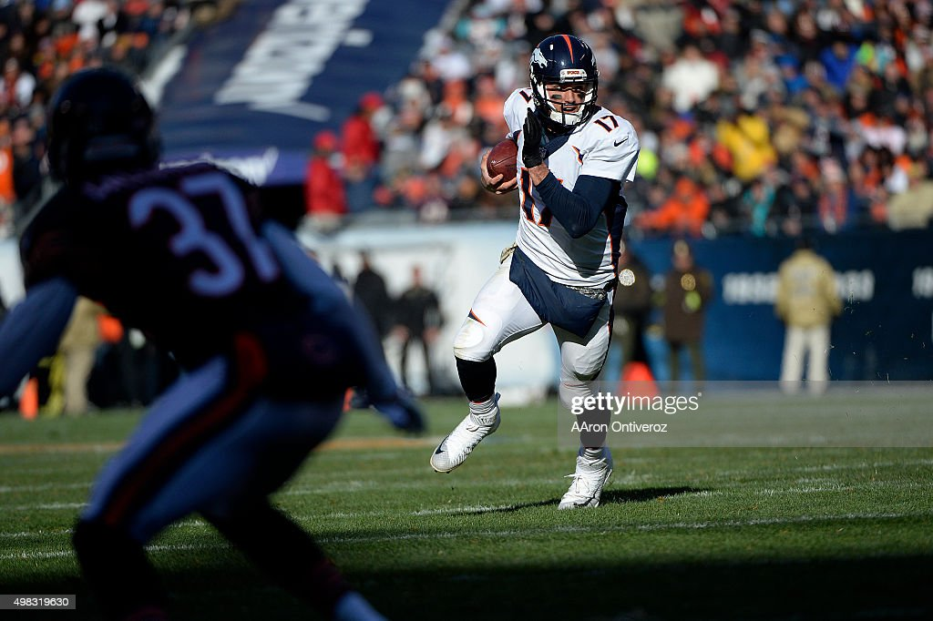 <a gi-track='captionPersonalityLinkClicked' href=/galleries/search?phrase=Brock+Osweiler&family=editorial&specificpeople=6501030 ng-click='$event.stopPropagation()'>Brock Osweiler</a> (17) of the Denver Broncos scrambles as Bryce Callahan (37) of the Chicago Bears reacts during the first half of action at Soldier Field. The Chicago Bears hosted the Denver Broncos on Saturday, August 29, 2015.