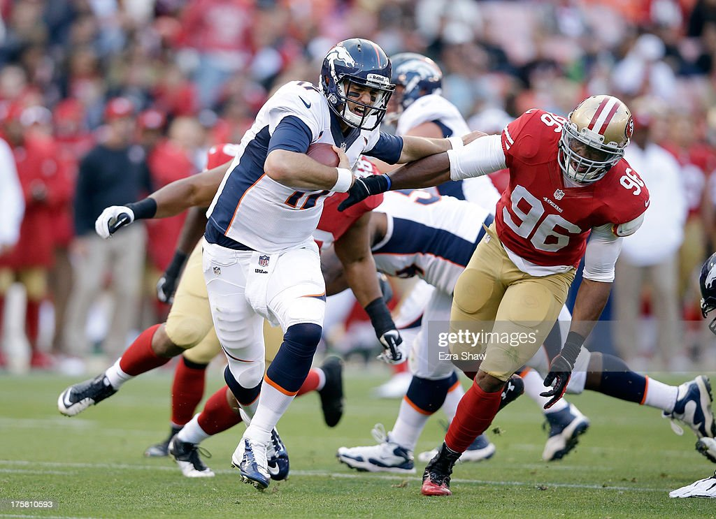 Brock Osweiler #17 of the Denver Broncos scrambles away from Corey Lemonier #96 of the San Francisco 49ers during their preseason NFL game at Candlestick Park on August 8, 2013 in San Francisco, California.