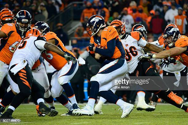 Brock Osweiler of the Denver Broncos tries to scramble but is brought down by Carlos Dunlap of the Cincinnati Bengals in the third quarter The Denver...