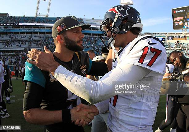 Brock Osweiler of the Houston Texans and Blake Bortles of the Jacksonville Jaguars shake hands during a game at EverBank Field on November 13 2016 in...