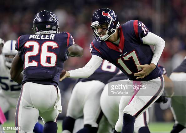 Brock Osweiler of the Houston Texans hands the ball to Lamar Miller of the Houston Texans during the NFL game between the Indianapolis Colts and the...