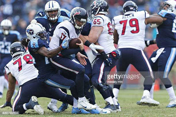 Brock Osweiler of the Houston Texans is sacked by Daimion Stafford of the Tennessee Titans at Nissan Stadium on January 1 2017 in Nashville Tennessee...