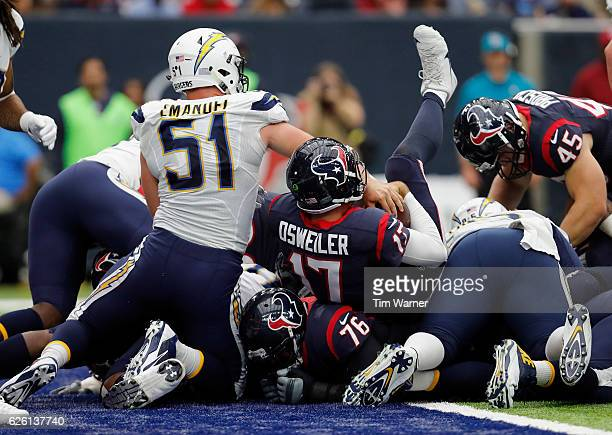 Brock Osweiler of the Houston Texans scores a touchdown on a quarterback sneak in the second quarter against the San Diego Chargers at NRG Stadium on...