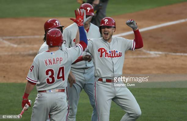 Brock Stassi of the Philadelphia Phillies celebrates with on deck hitter Andrew Knapp after hitting a three run home run to also bring in Maikel...