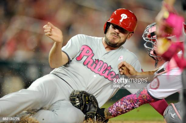 Brock Stassi of the Philadelphia Phillies is taggeg out at home plate in the sixth inning by Jose Lobaton of the Washington Nationals at Nationals...