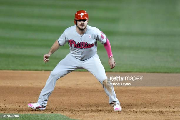 Brock Stassi of the Philadelphia Phillies leads off first base during game two of baseball game against the Washington Nationals at Nationals Park on...