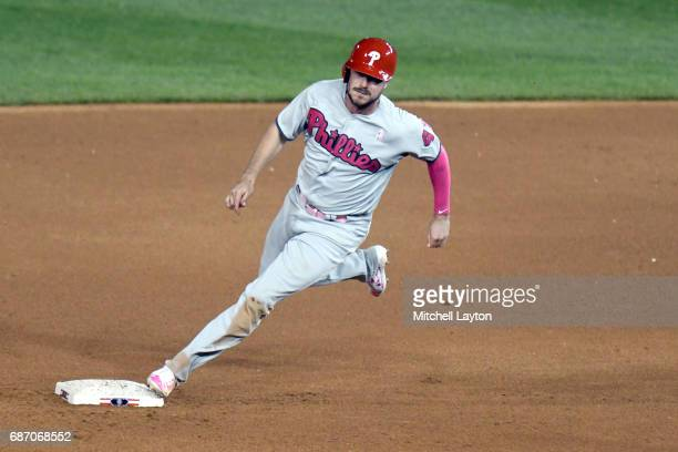Brock Stassi of the Philadelphia Phillies runs past second base during game two of baseball game against the Washington Nationals at Nationals Park...