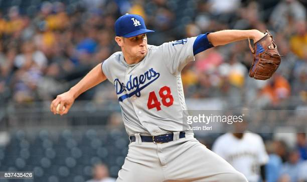 Brock Stewart of the Los Angeles Dodgers delivers a pitch in the first inning during the game against the Pittsburgh Pirates at PNC Park on August 22...