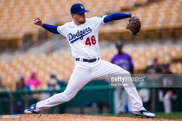 Brock Stewart of the Los Angeles Dodgers pitches in the fourth inning during a spring training game against the Colorado Rockies at Camelback Ranch...