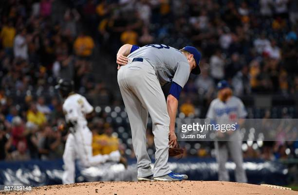 Brock Stewart of the Los Angeles Dodgers reacts as Starling Marte of the Pittsburgh Pirates rounds the bases after hitting a two run home run in the...