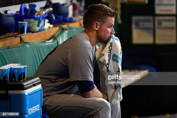Brock Stewart of the Los Angeles Dodgers sits in the dugout after being removed in the third inning during the game against the Pittsburgh Pirates at...