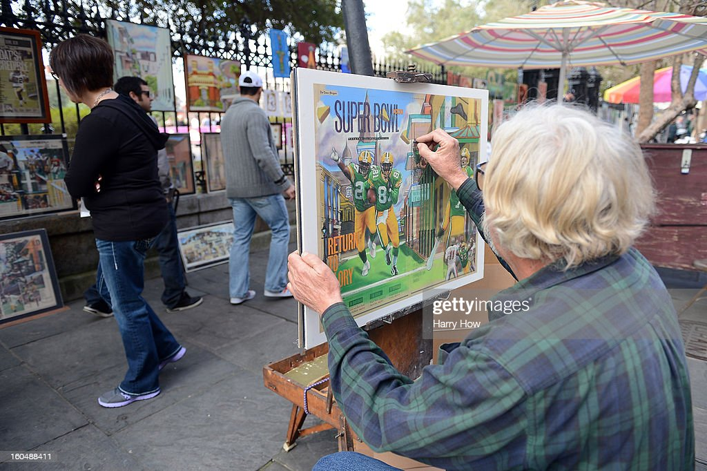 Brock Swanson paints a Super Bowl image for sale at his stand around Jackson Square in the French Quarter before Super Bowl XLVII on February 1, 2013 in New Orleans, Louisiana.