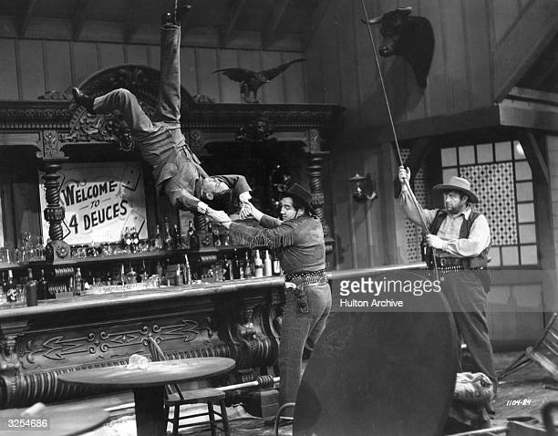 Broderick Crawford Andy Devine and Franchot Tone engage in a saloon bar brawl in a scene from the film 'Trail Of The Vigilantes' directed by Allan...