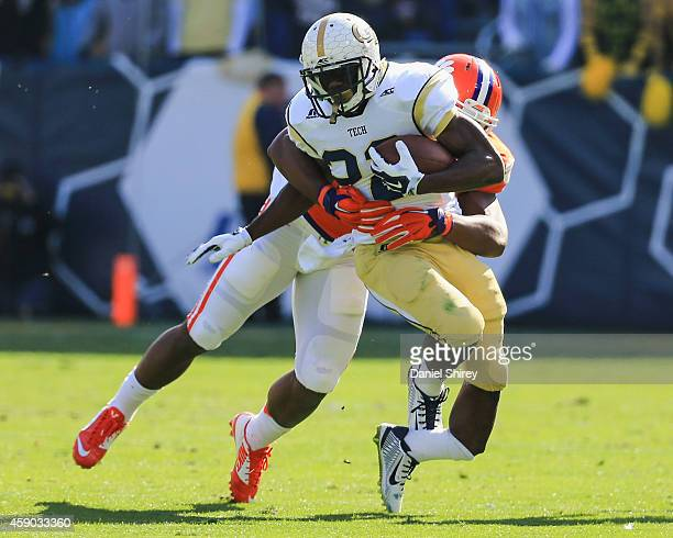 Broderick Snoddy of the Georgia Tech Yellow Jackets suffers an injury as he is tackled by Stephone Anthony of the Clemson Tigers on a run play during...